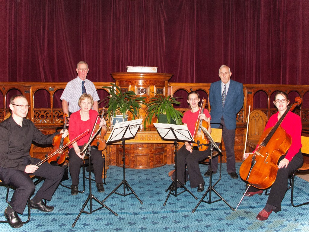 Musicians from the Tod Orchestra's string quartet with speaker Trevor Drive and Peter Gibson of U3