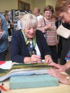 National Chairman Barbara Lewis learns 'felting' from U3A Todmorden craft group members at the September coffee morning